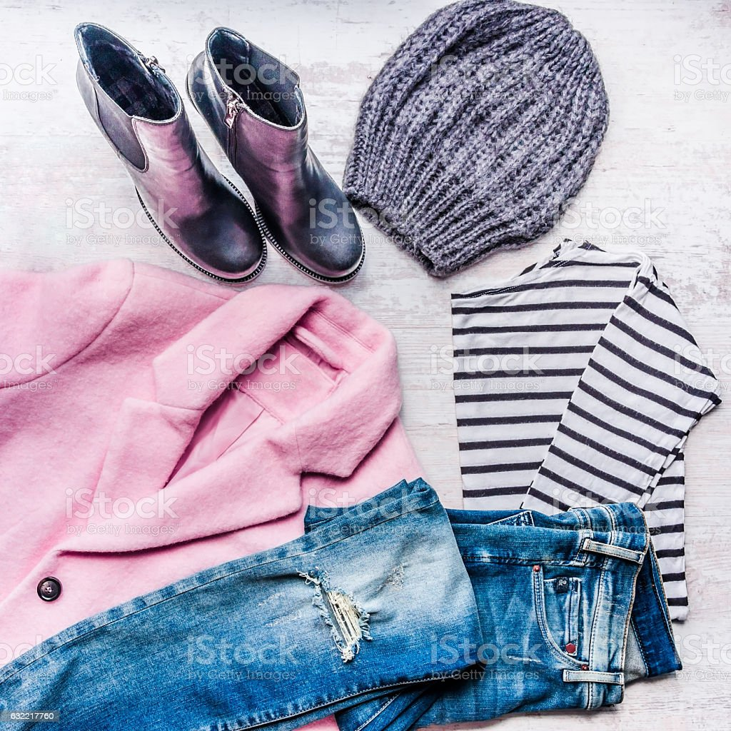Collage of autumn-winter female clothing set. Pink coat, blue jeans. stock photo