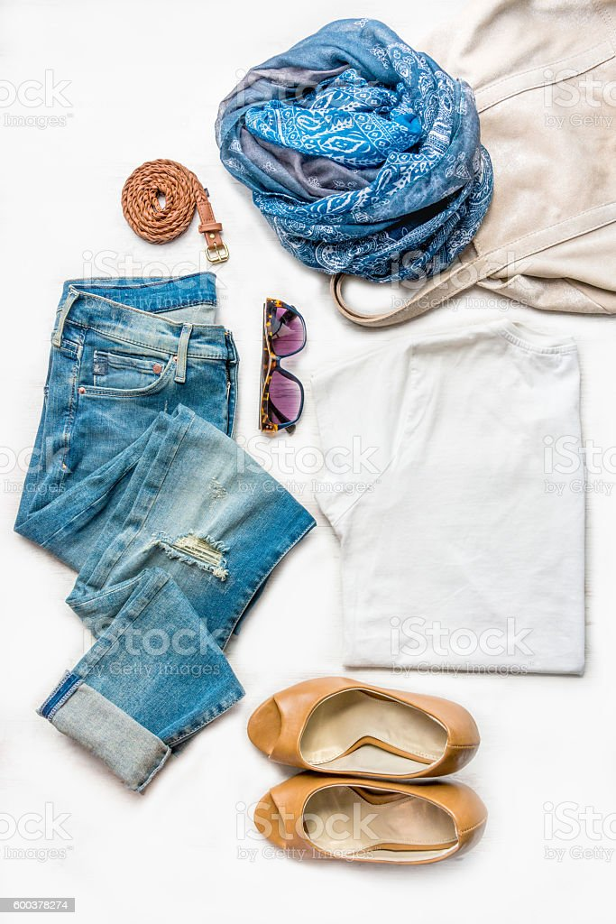 Collage of female clothing set. Jeans, top, shoes and accessories. stock photo