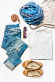 Collage of female clothing set. Jeans, top, shoes and accessories.