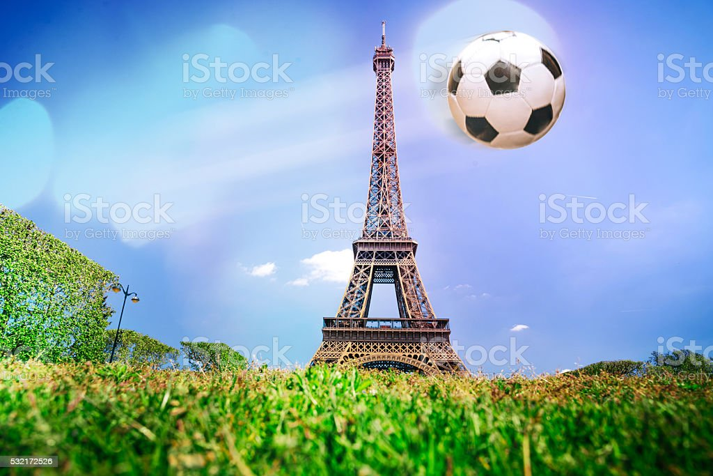 collage with Eiffel Tower and flying soccer ball stock photo