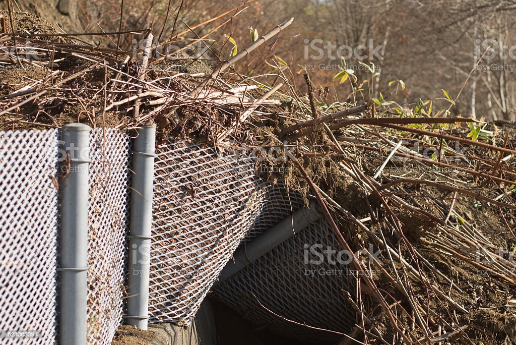 Collapsed fence stock photo