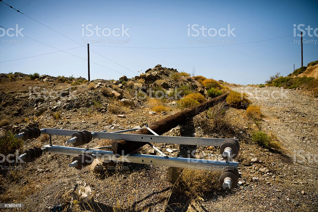 Collapsed power line pole stock photo