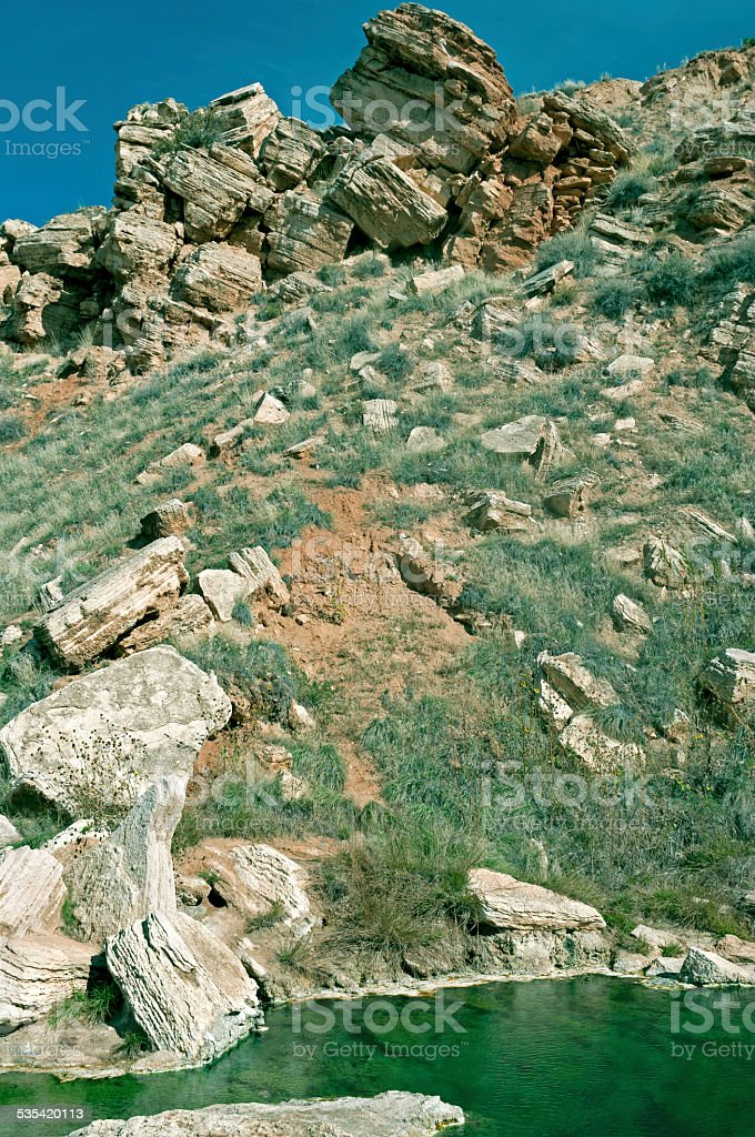 Collapsed rocks above hot spring at park in Thermopolis WY stock photo