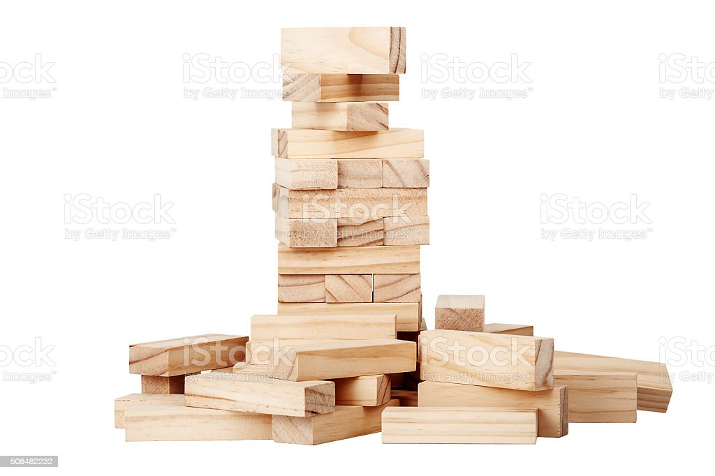 Collapsed wooden blocks tower stock photo