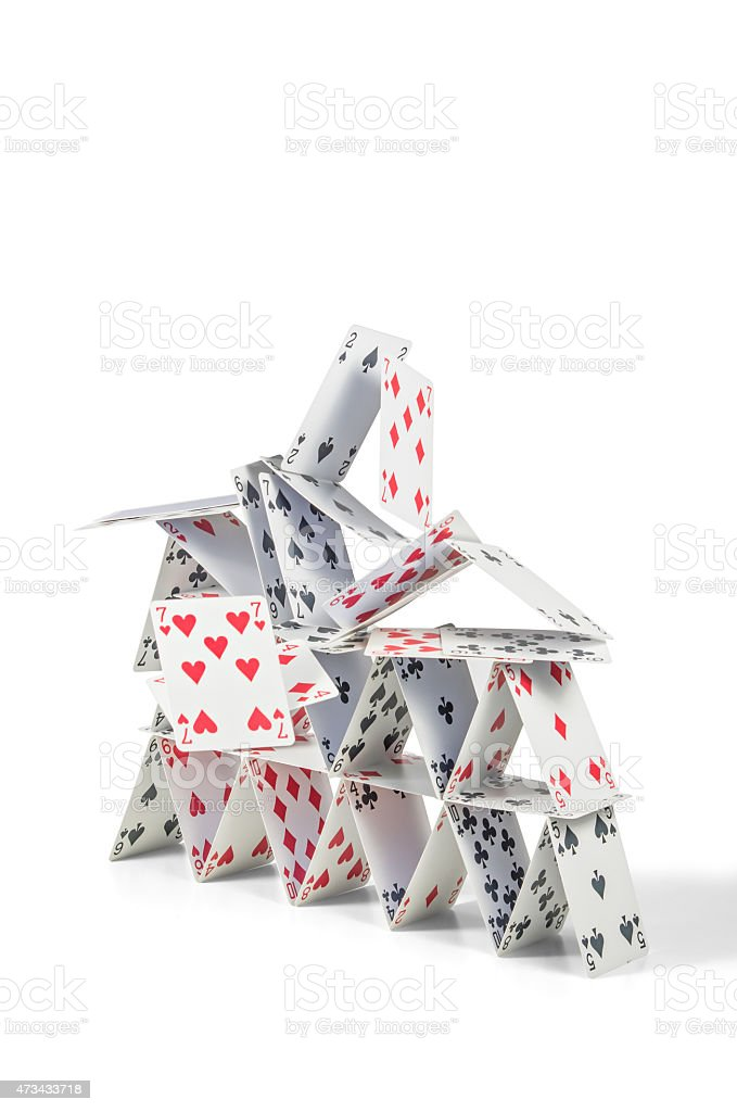 collapsing house of cards stock photo