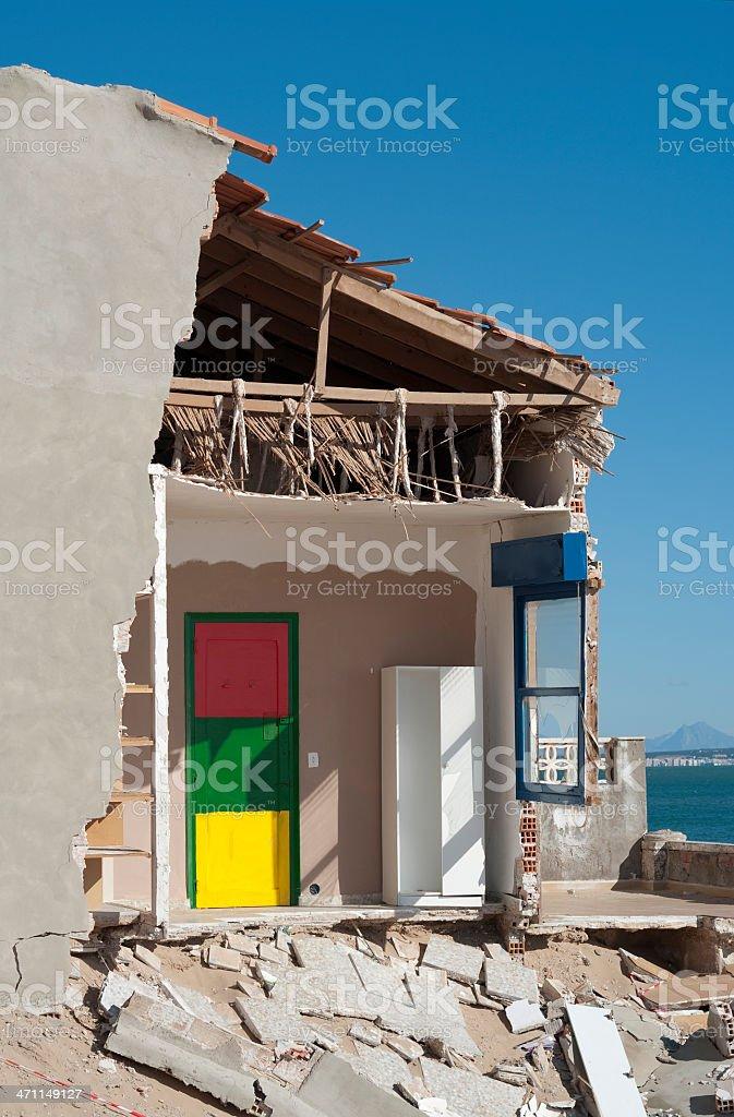 Collapsing seaside house. Property Crash. royalty-free stock photo