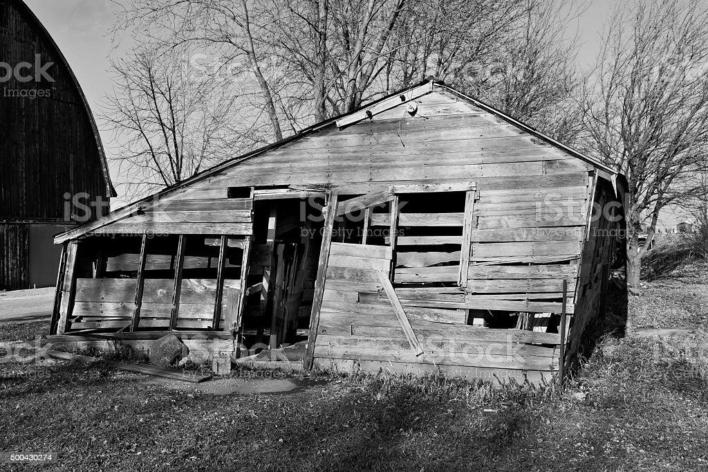 collapsing weathered shack stock photo