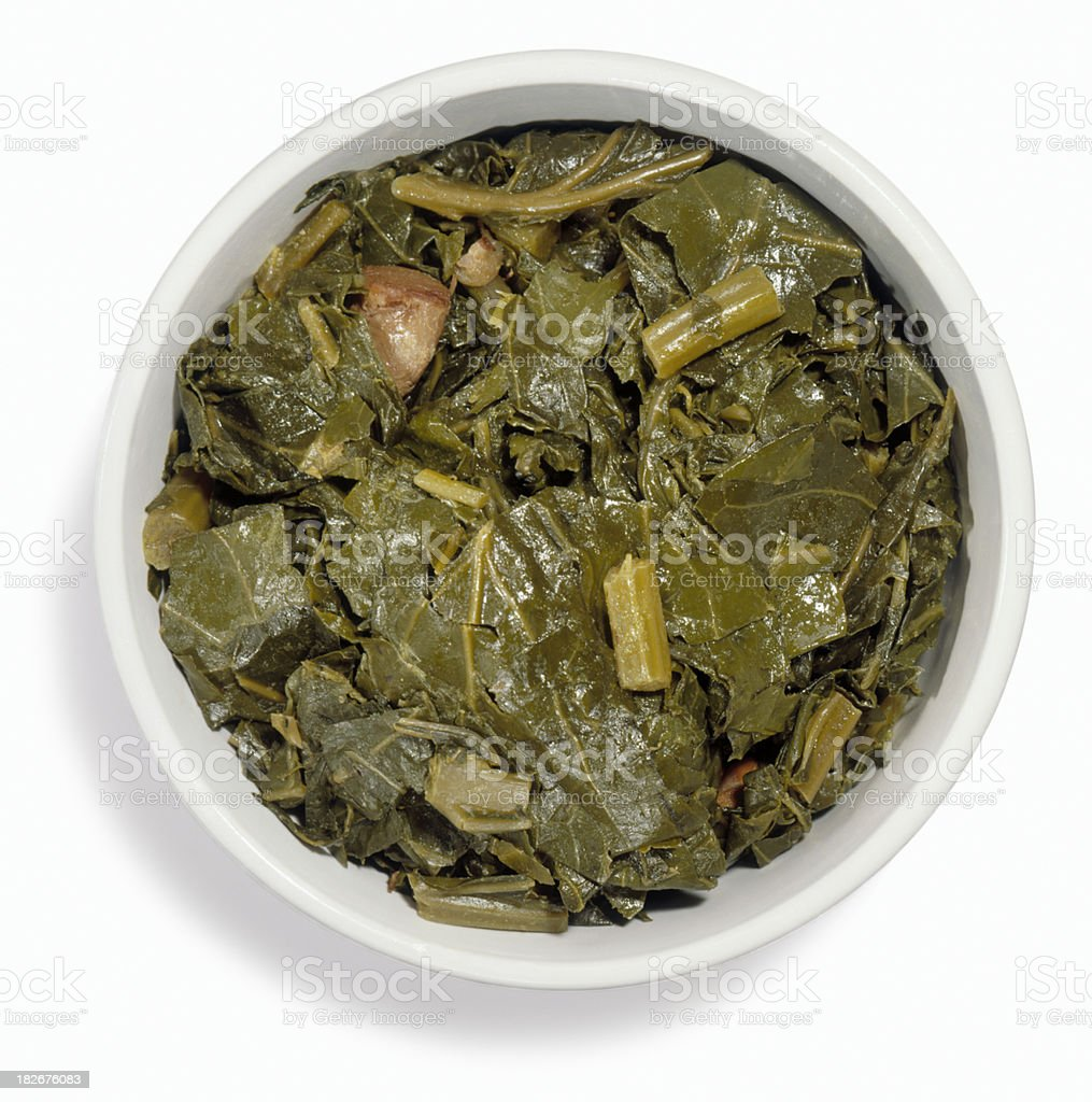 Collard greens cut out on white stock photo