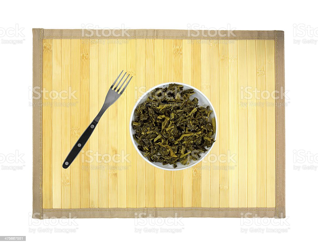 Collard greens in dish with a fork to the side royalty-free stock photo
