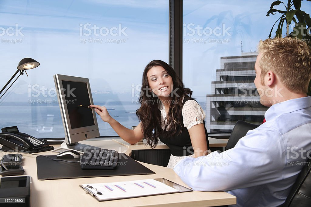Colleagues Analyzing Data royalty-free stock photo