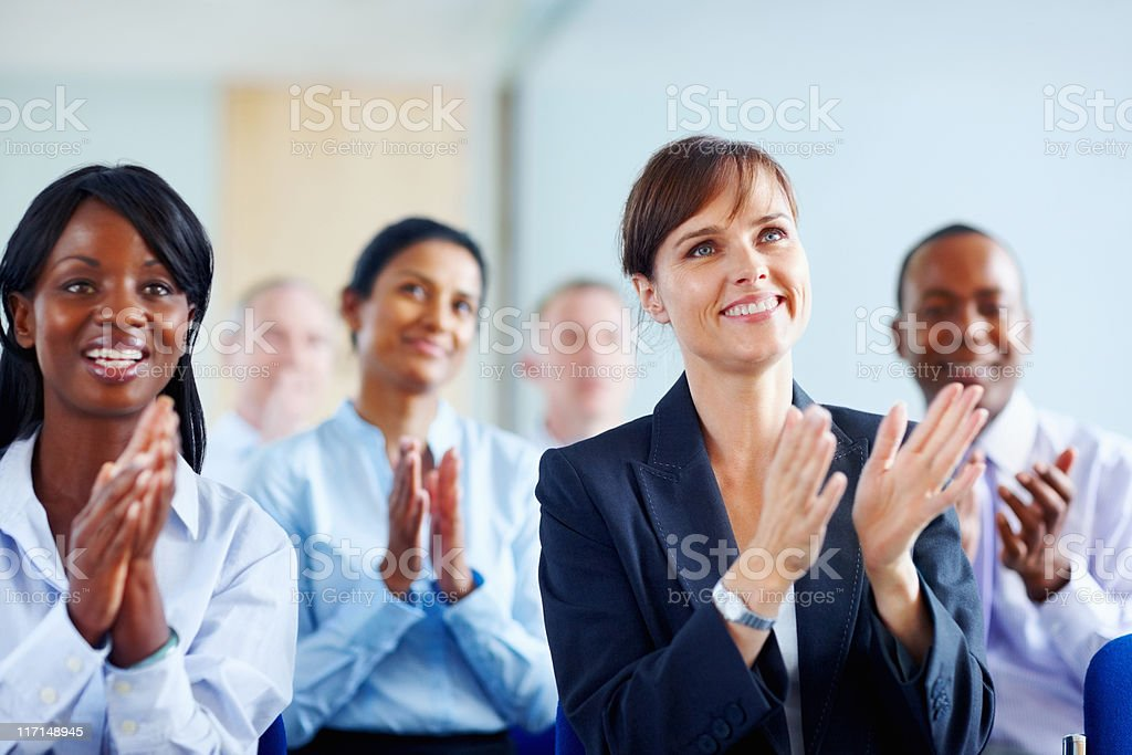 Colleagues applauding presentation royalty-free stock photo