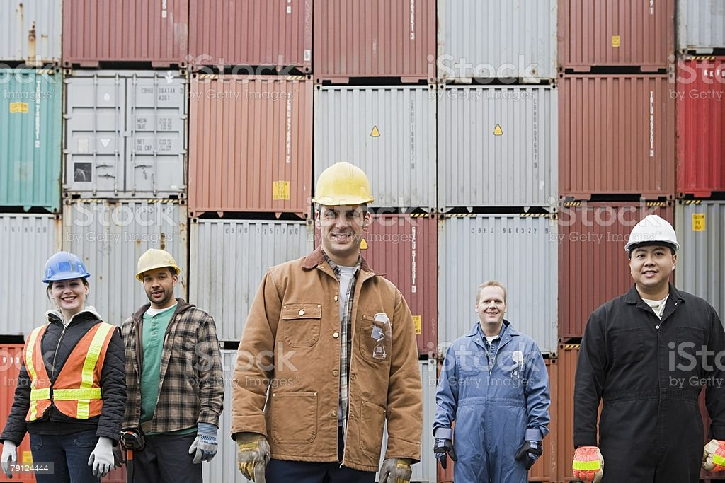 Colleagues at container terminal stock photo