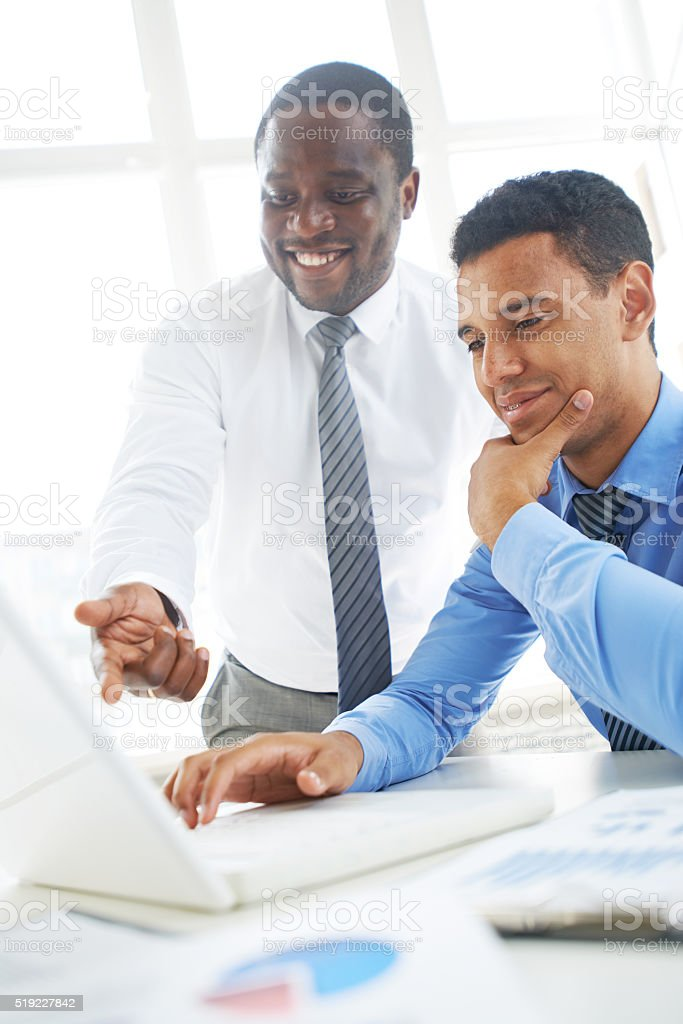 Colleagues at work stock photo