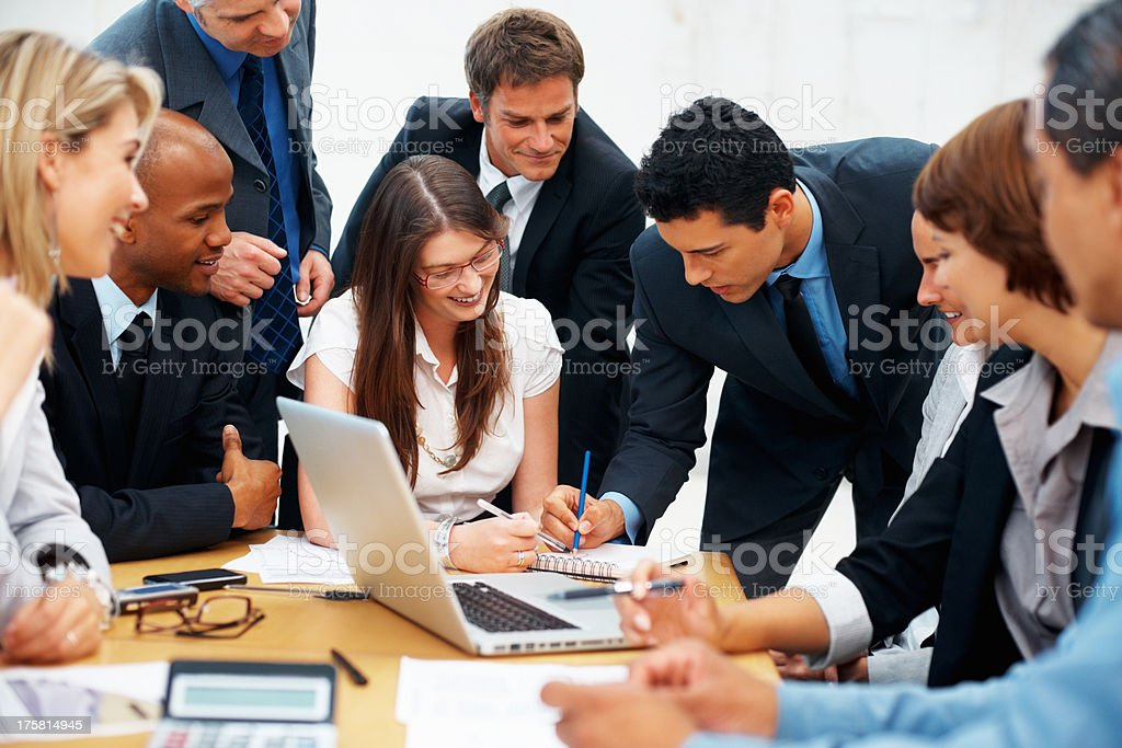 Colleagues brainstorming during meeting stock photo
