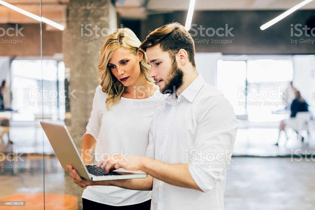 Colleagues brainstorming in the office stock photo