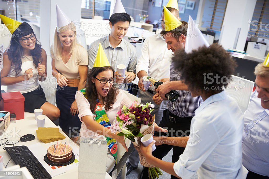 Colleagues celebrating a birthday at the office stock photo