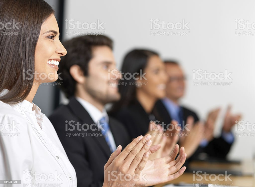 colleagues clapping in a meeting stock photo