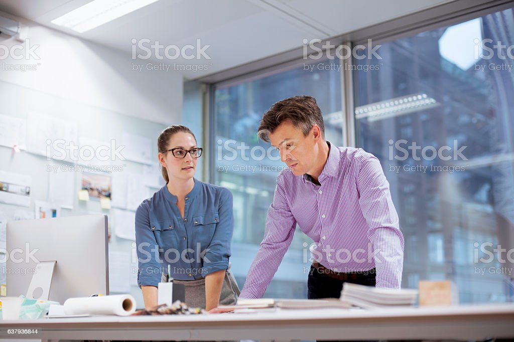 Colleagues collaborating in design studio office stock photo