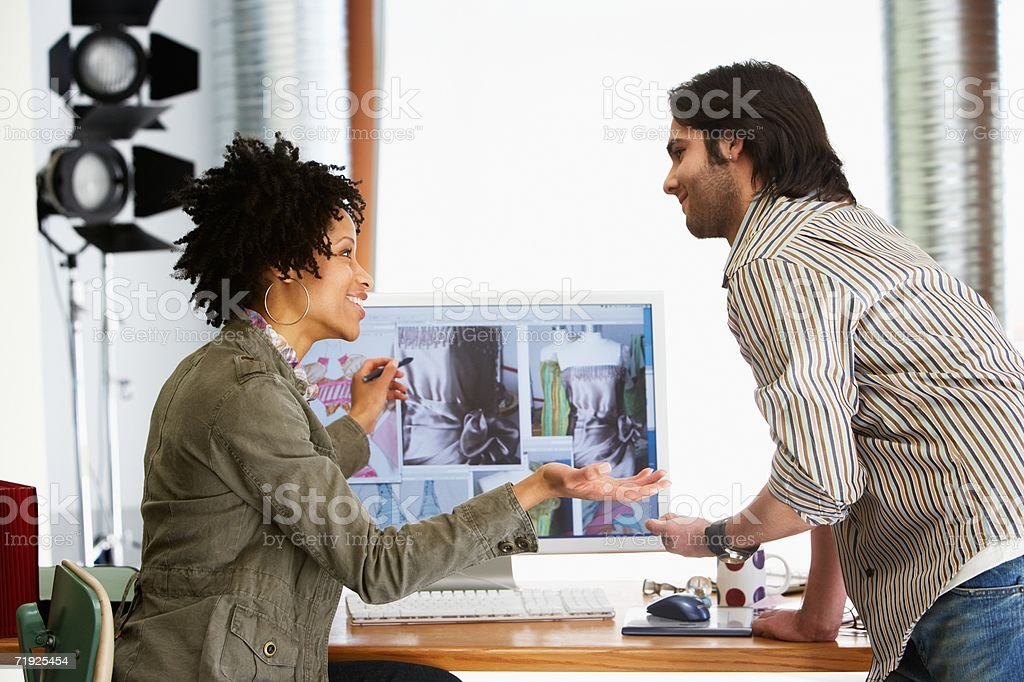 Colleagues discussing designs royalty-free stock photo