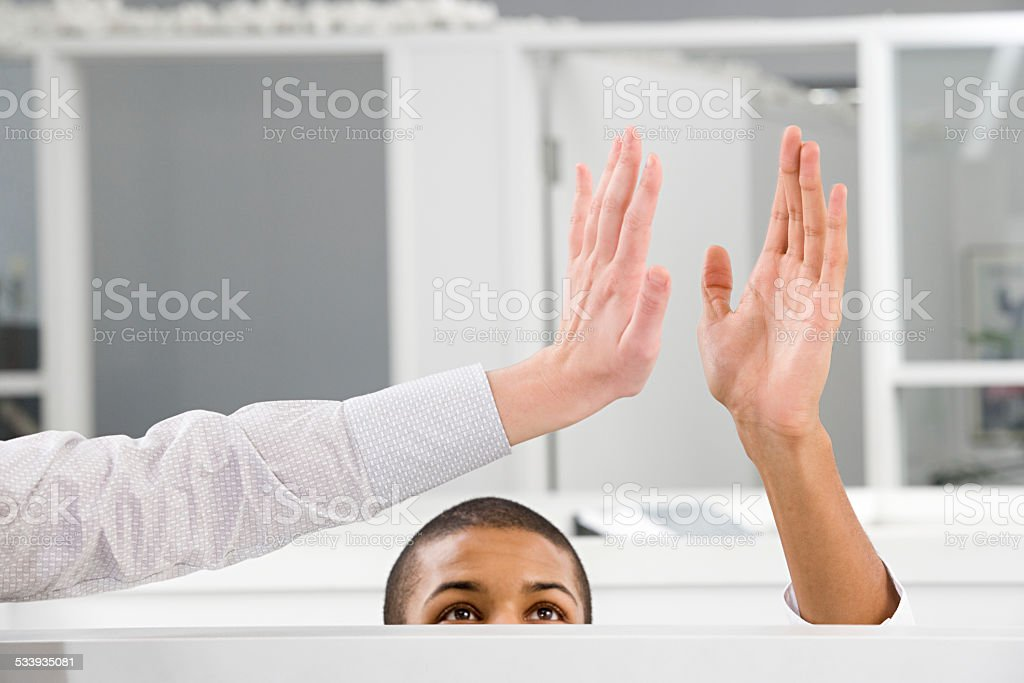 Colleagues doing high five stock photo