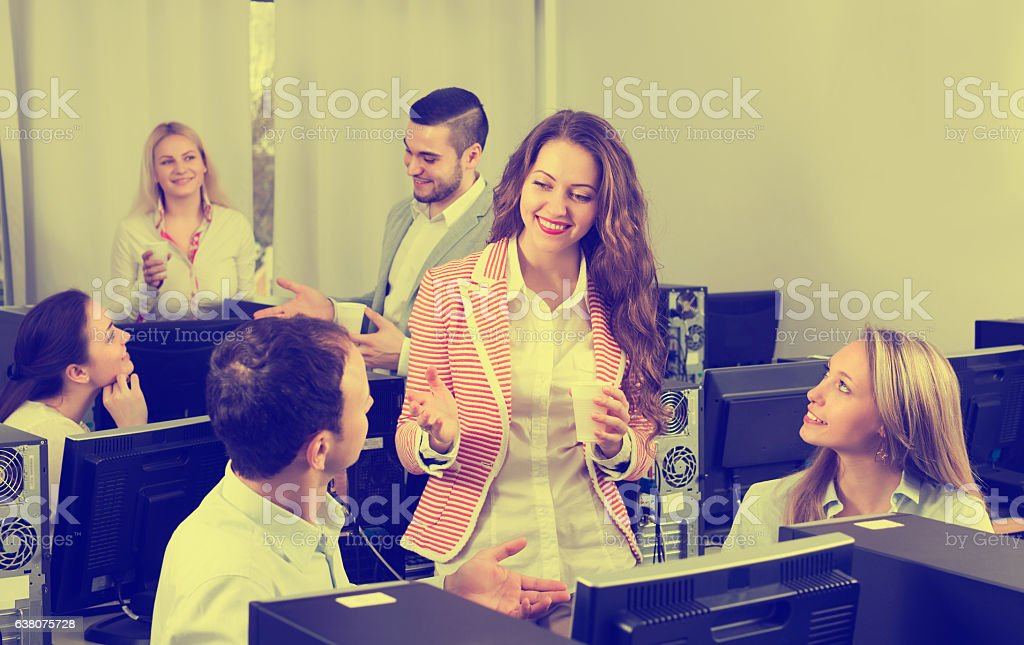 Colleagues drinking champagne at office stock photo