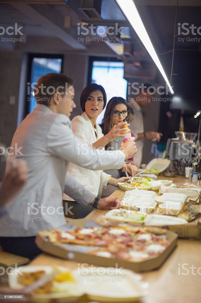 Colleagues eating together on lunch brreak stock photo