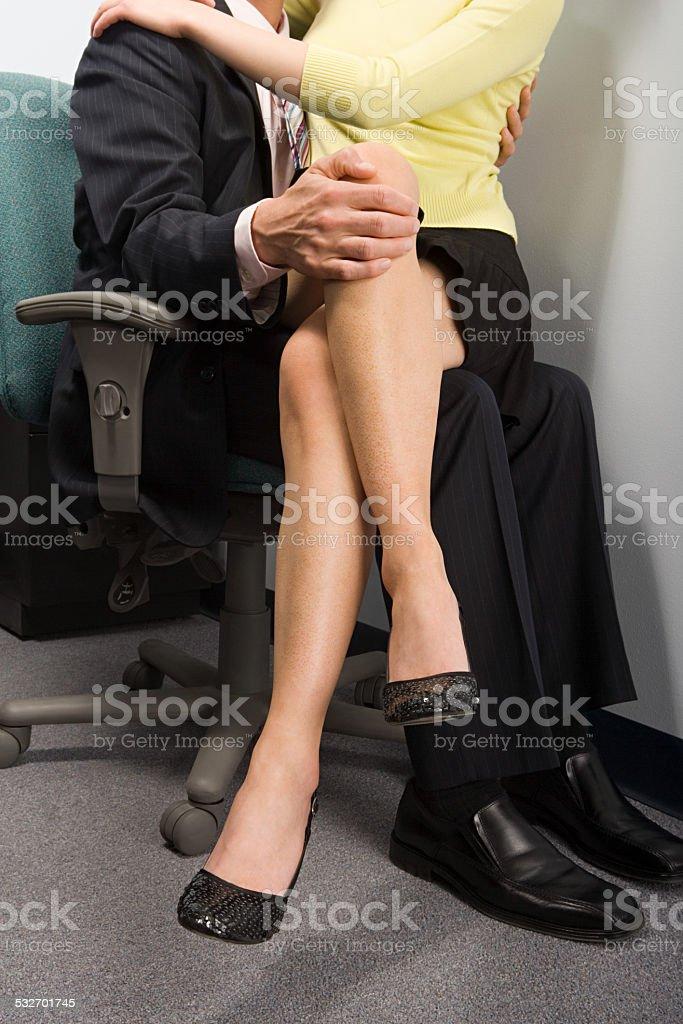 Colleagues embracing stock photo