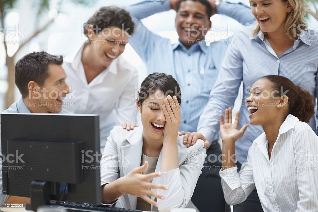 Colleagues enjoying  laugh on a funny email royalty-free stock photo
