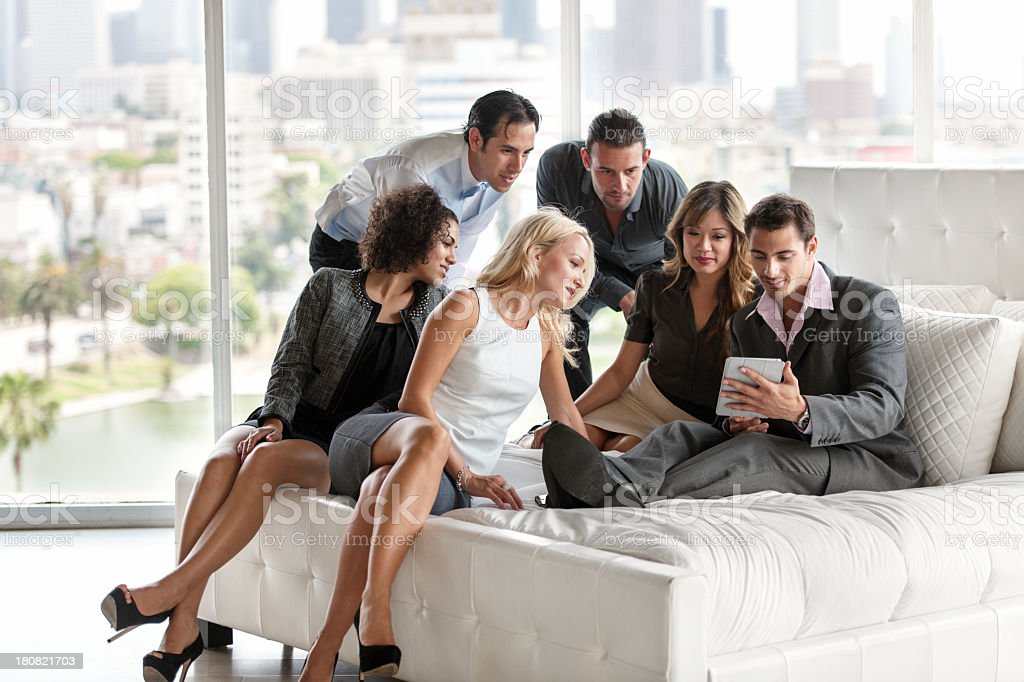 Colleagues having casual meeting in hotel room royalty-free stock photo