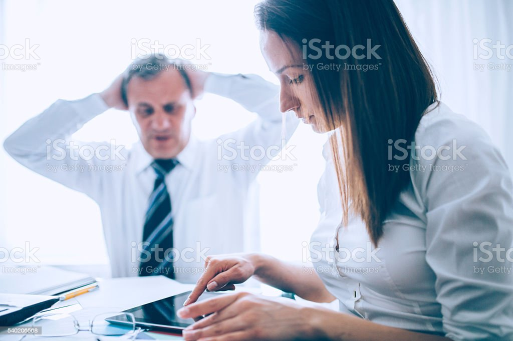 Colleagues having problems stock photo