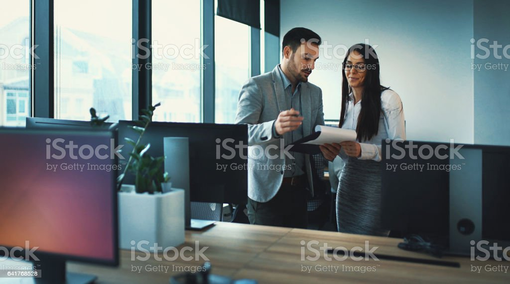 Colleagues in a brief meeting. stock photo