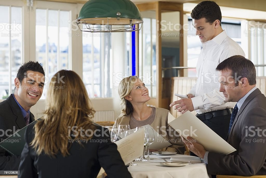 Colleagues in a restaurant royalty-free stock photo