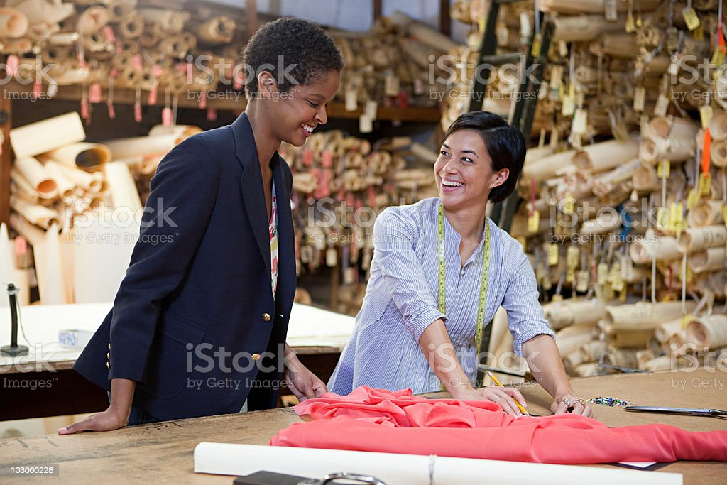 Colleagues in clothing factory royalty-free stock photo