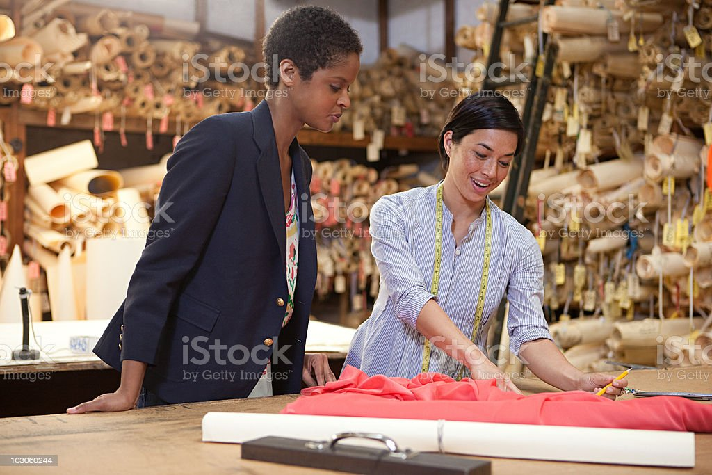 Colleagues in clothing factory stock photo