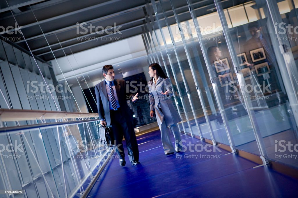 Colleagues in deep discussion royalty-free stock photo