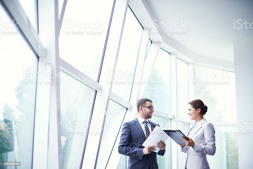 Colleagues in office building stock photo
