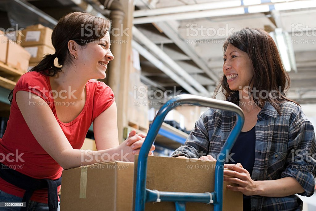 Colleagues in warehouse stock photo