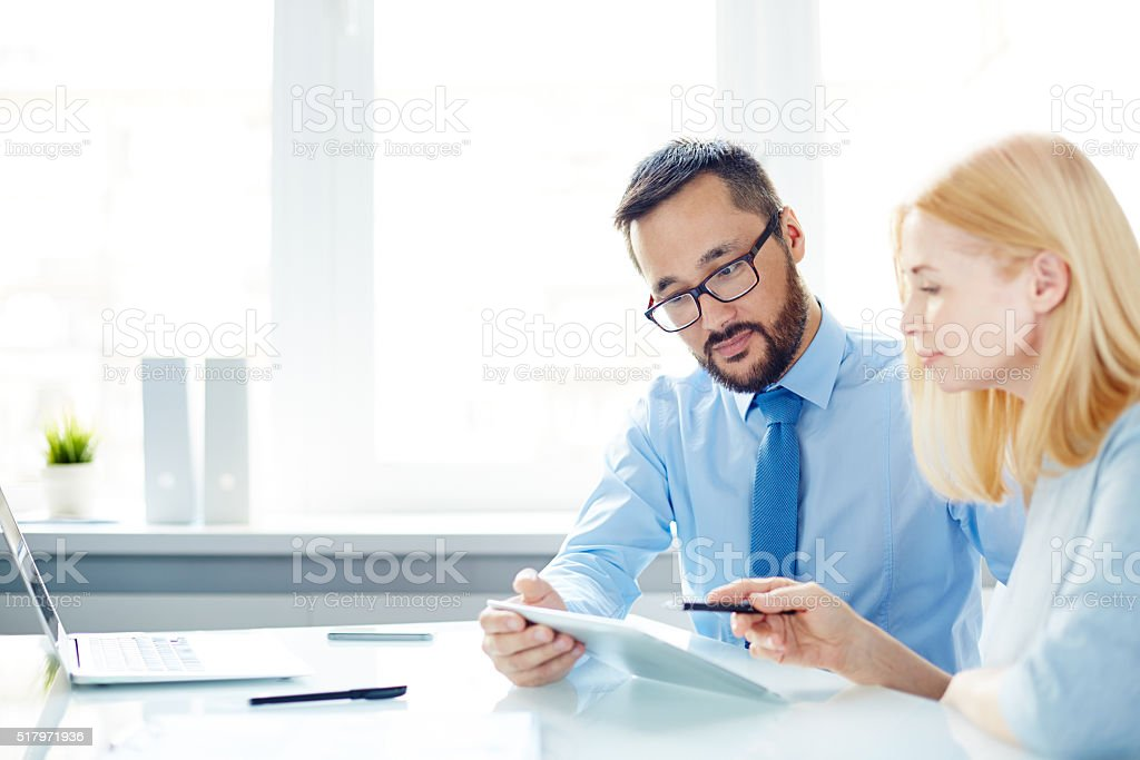 Colleagues interacting stock photo