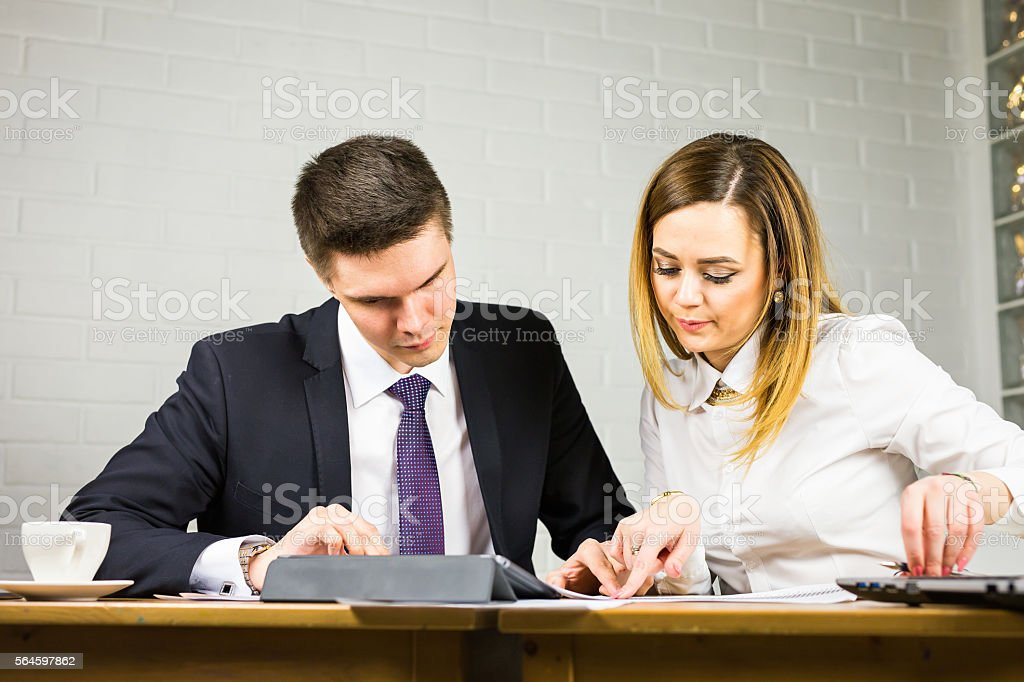 Colleagues interaction. Female office member paying attention to ideas of stock photo