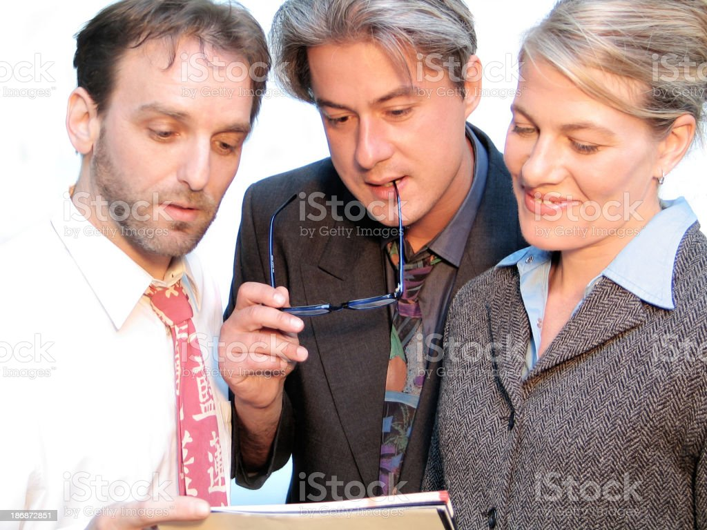Colleagues looking at a document royalty-free stock photo