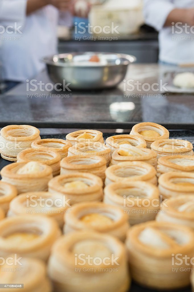 Colleagues making vol-au-vent together stock photo