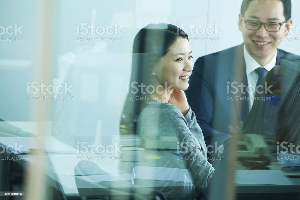 Colleagues Meeting in Conference Room, Shot Through Glass royalty-free stock photo