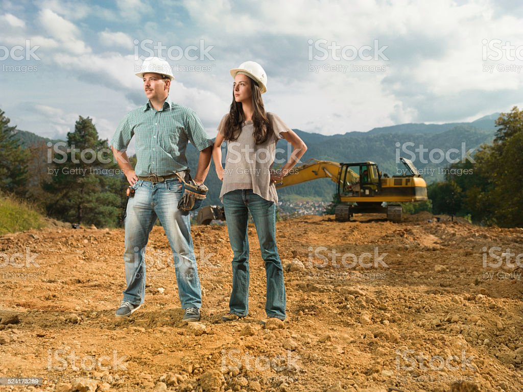 colleagues on construction site stock photo