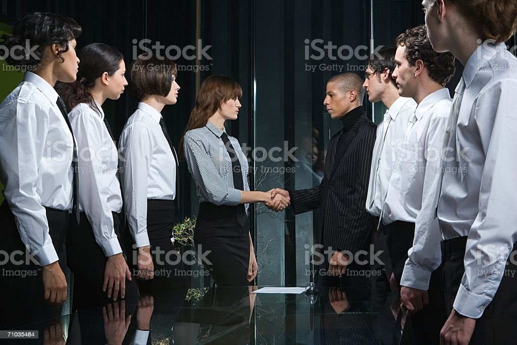 Colleagues shaking hands stock photo