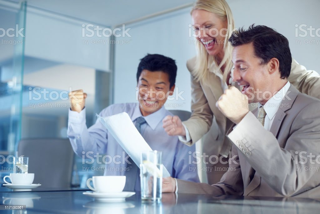Colleagues smiling and clenching fists in excitement royalty-free stock photo