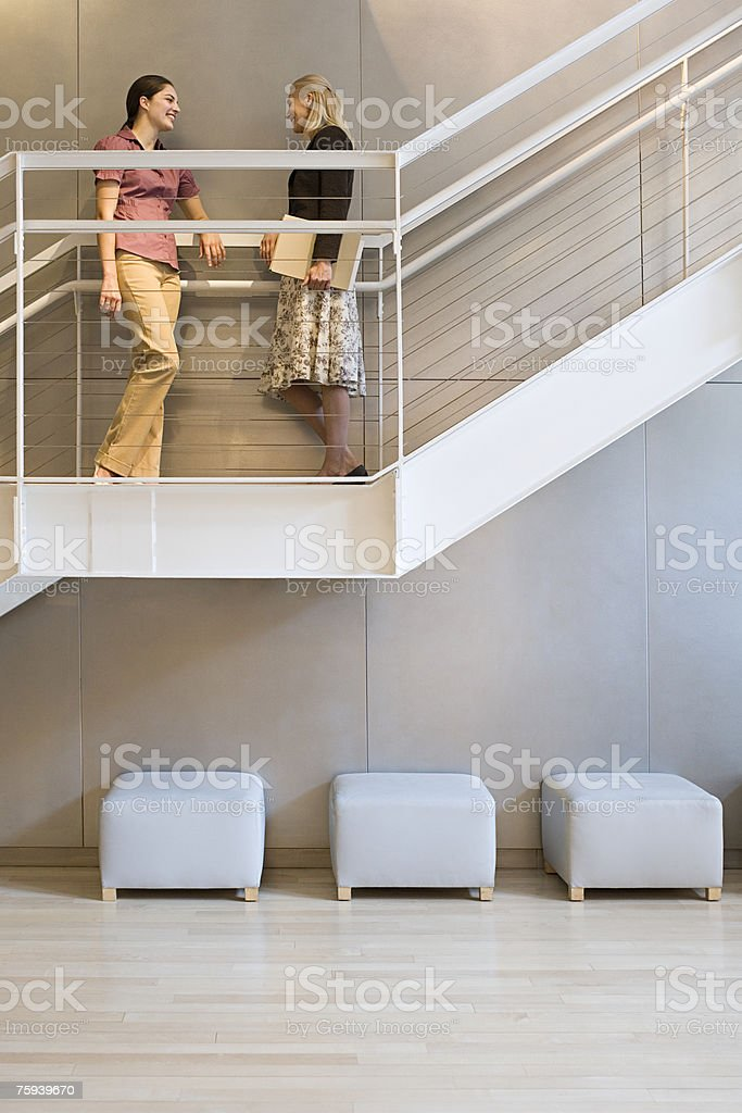Colleagues talking on stairs royalty-free stock photo