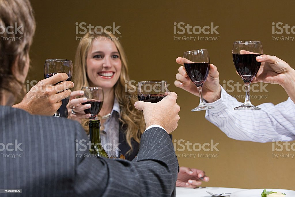 Colleagues toasting with wine stock photo