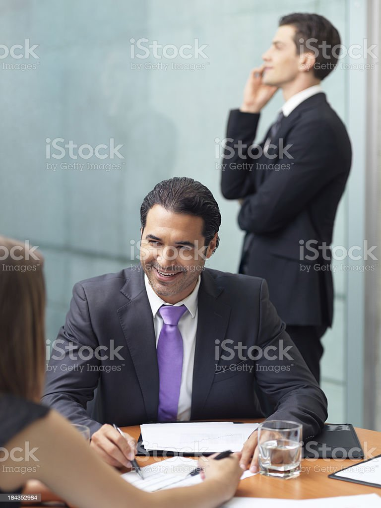Colleagues working in the office royalty-free stock photo