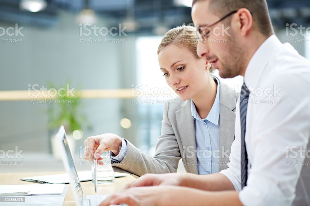 Colleagues working stock photo