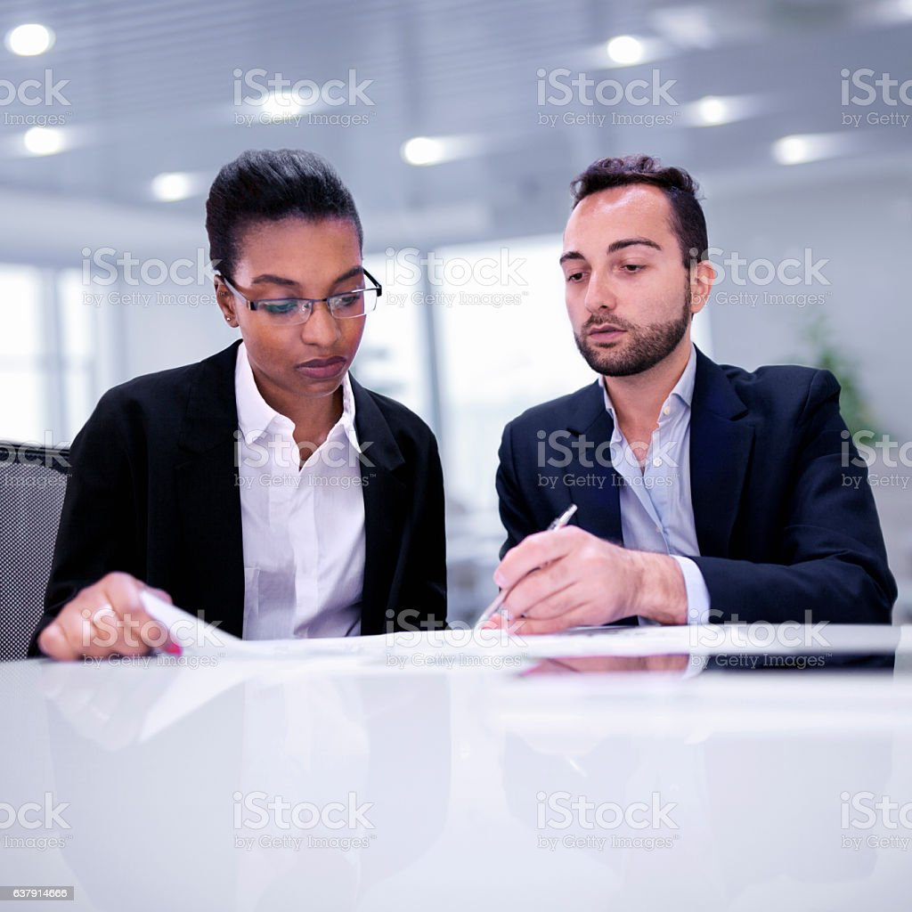 Colleagues working together during discussion in office stock photo